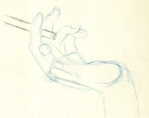 doigts qui tiennent une cigarette